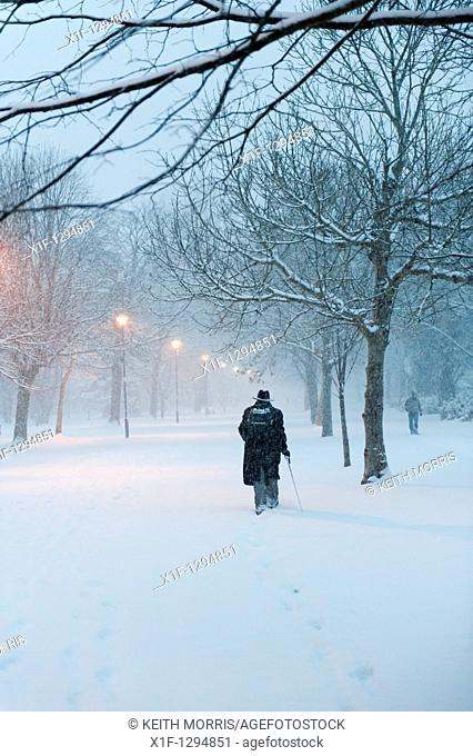 Early morning, people walking in the snow, Aberystwyth, Wales, UK, december