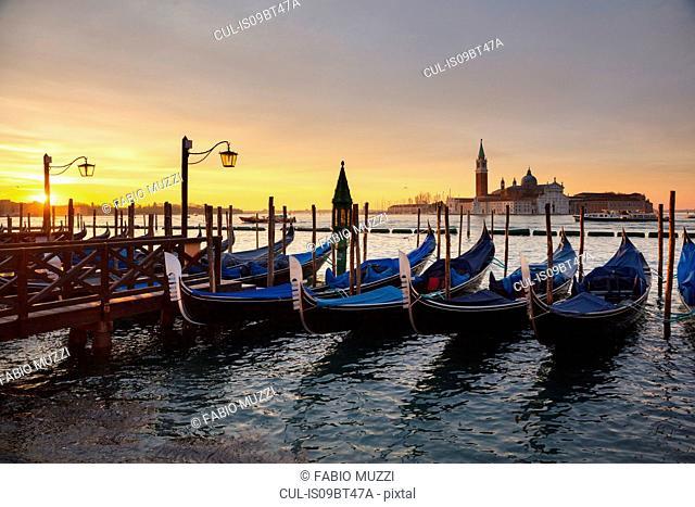 Gondolas by St Marks Square at sunrise, Venice, Veneto, Italy