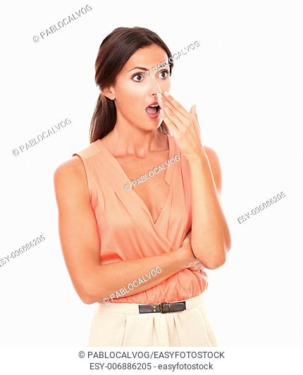 Pretty latin lady with hand gesturing error while looking to her left embarrassed and surprised in white background - copyspace