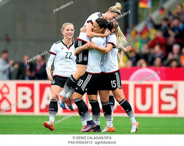 Germany's Tabea Kemme, goal-scorer Anja Mittag, Dzsenifer Marozsan, and Mandy Islacker celebrate the 3-1 goal during the women's international soccer match...