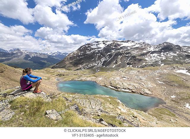 The hiker admiring the view of Bei Laghetti in Sobretta Valley, Santa Caterina Valfurva, Province of Sondrio, Valtellina, Lombardy, Italy, Europe