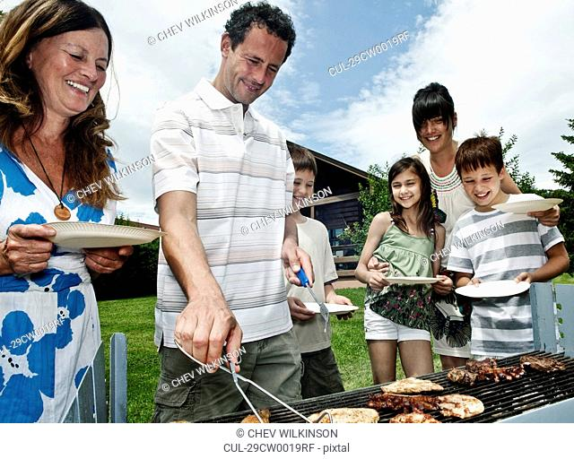 Family queueing for barbeque