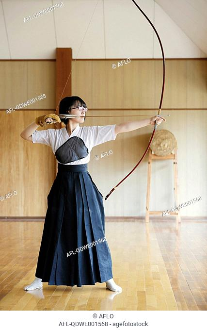 Japanese traditional Kyudo archery athlete practicing