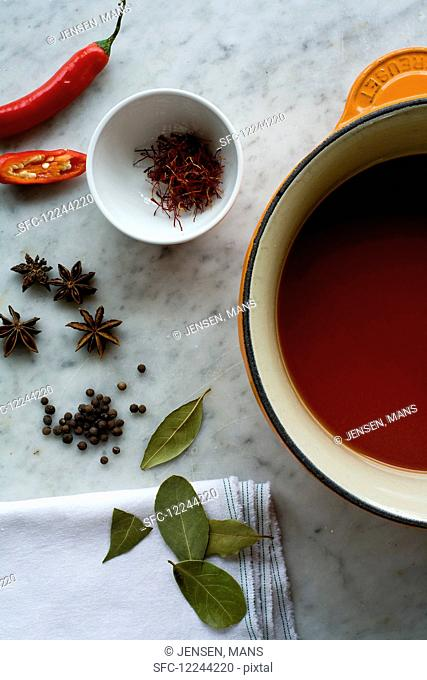 Tomato broth, bay leaves, peppercorns, star anise, saffron and chillies