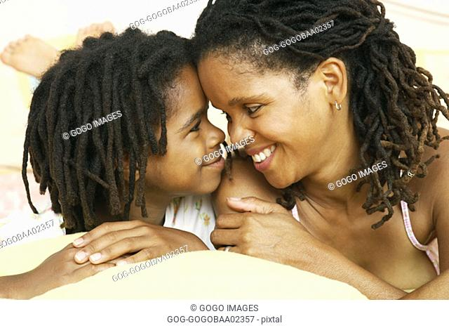 African mother and daughter smiling together