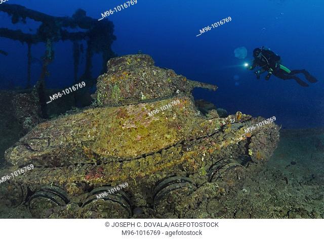 Scuba diver views Japanese battle tank on shipwreck San Francisco Maru, Maru, Chuuk, Micronesia, Pacific