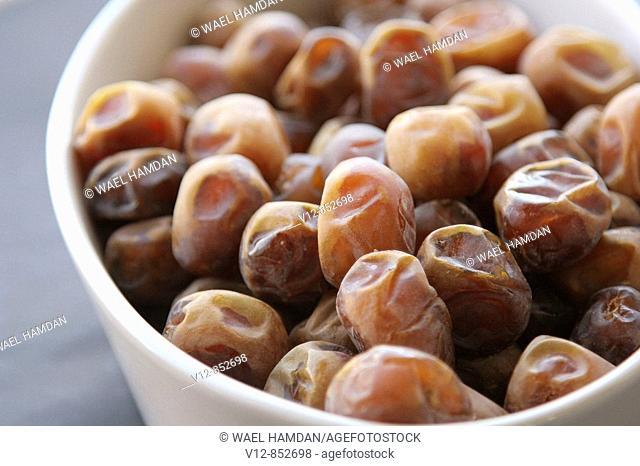 close-up Fresh arabian dates on bowl