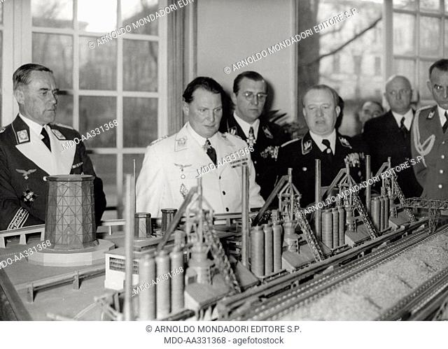 Hermann Goering in front of a plastic model of an industrial complex. The feldmarshal Hermann Goering, as chief administrator of 'Four year plans' of the Reich