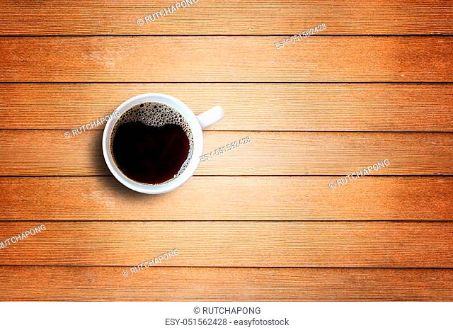 Cup of coffee on wood table background with copy space for any design. Coffee Mug on Wooden Table