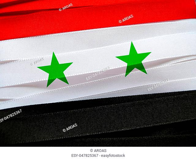 Syria flag or banner made with red, white and black ribbons