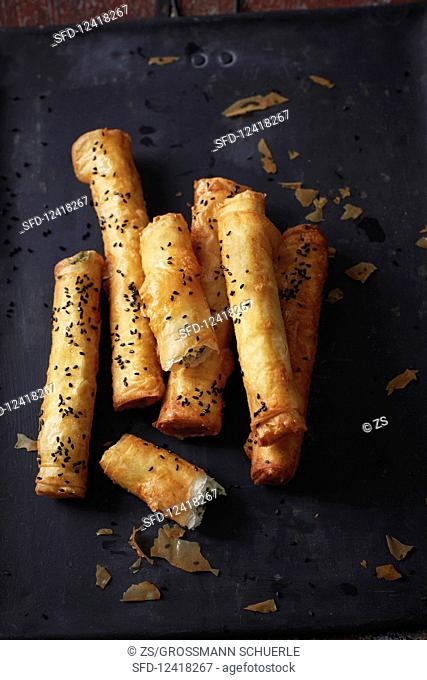 Sambose (fried filo pastry rolls filled with parsley and cheese, Syria)