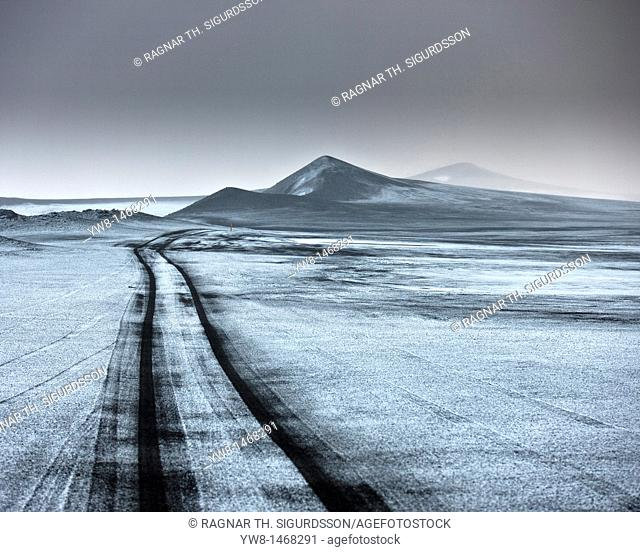 Light snow on ash filled landscape wth jeep tracks off road  Iceland  Asf fall from the Grimsvotn, volcano eruption which began on May 21, 2011
