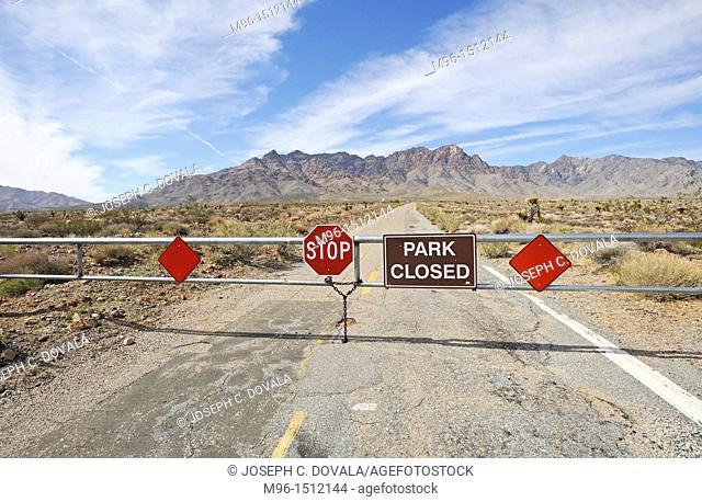 California State Park closed gate, Providence Mountains, Mojave Desert, California, USA