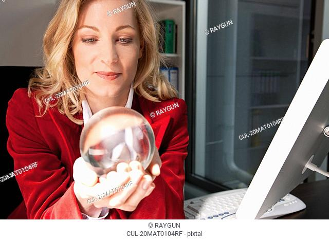 Businesswoman holding a crystal ball