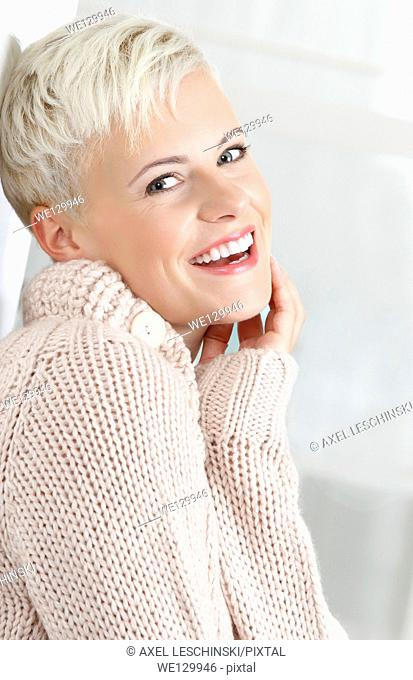 Woman in cardigan smiling