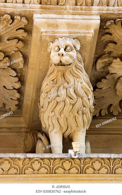 Lion statue at the Basilica of Santa Croce or Church of the Holy Cross is a famous baroque church in Lecce, a historic city in Apulia, Southern Italy