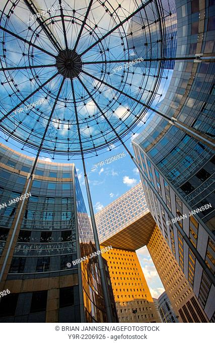 View looking up at modern architecture of La Defense, Paris France