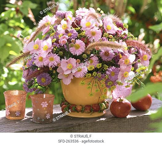Summery arrangement of pink anemones and asters