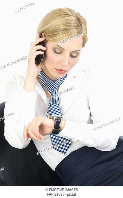 Businesswoman checking the time