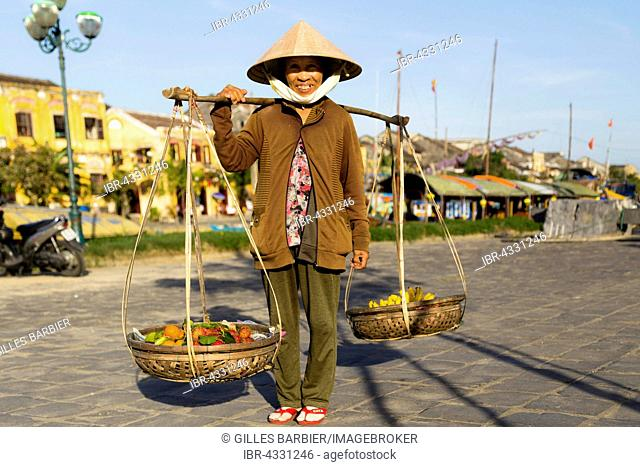 Woman selling fruits, Old Town of Hoi An, Vietnam
