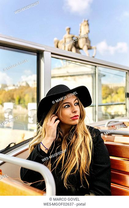 France, Paris, woman on a tour bus