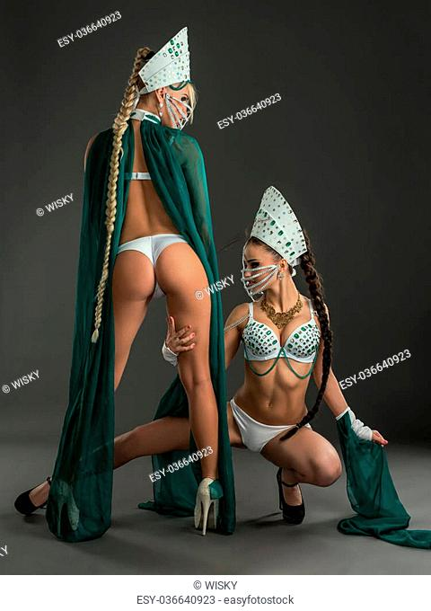 Image of beauties with long plaits in suits for erotic dances