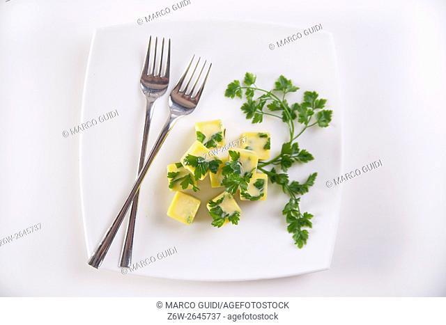 Frozen cubes of extra virgin olive oil flavored with parsley