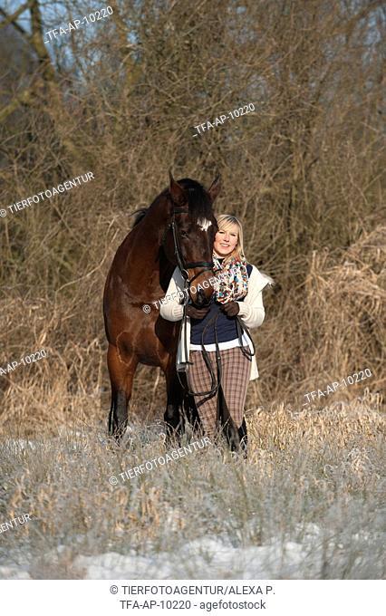 woman with bavarian warmblood
