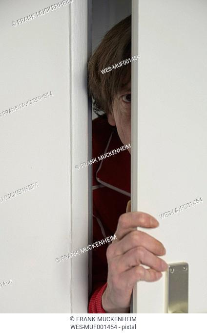 Man looking man opening door