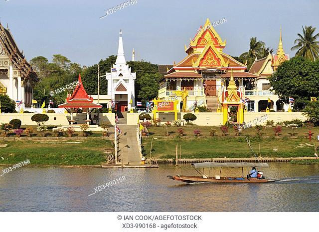 longtail sampan in Pasak River with Wat Monthop, Ayutthaya, Thailand