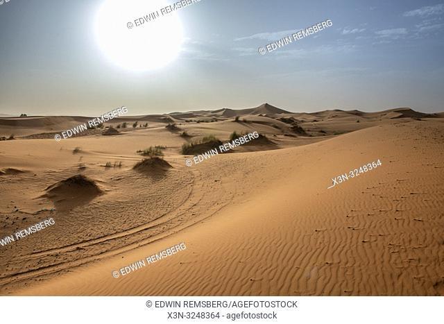 The blazing sun hangs over the Desert in Merzouga, Morocco