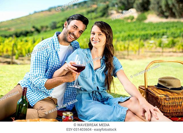 Portrait of cheerful couple holding wineglasses