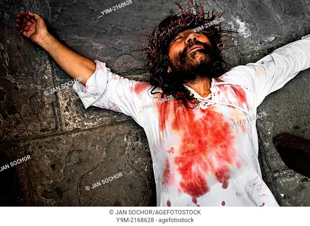 A Peruvian actor Mario Valencia, performing as Jesus Christ, lies on the ground in the Good Friday procession during the Holy week in Lima, Peru, 30 March 2013