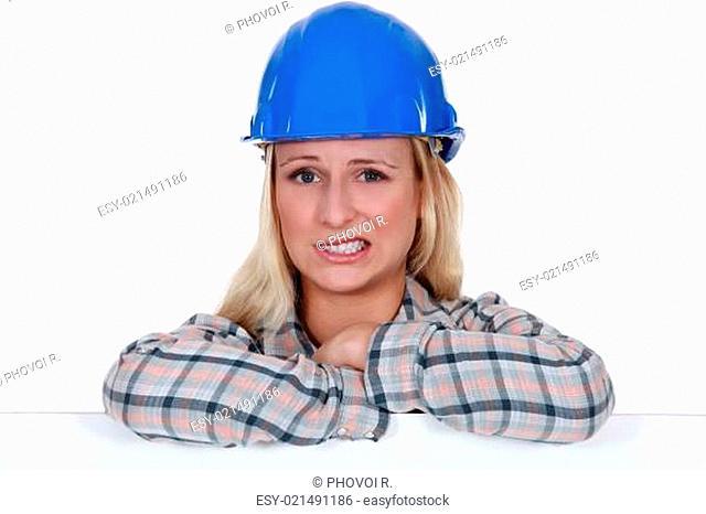 Apprehensive female builder