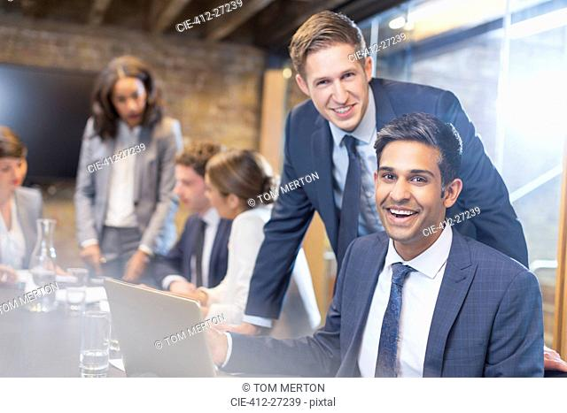 Portrait confident businessmen in conference room meeting
