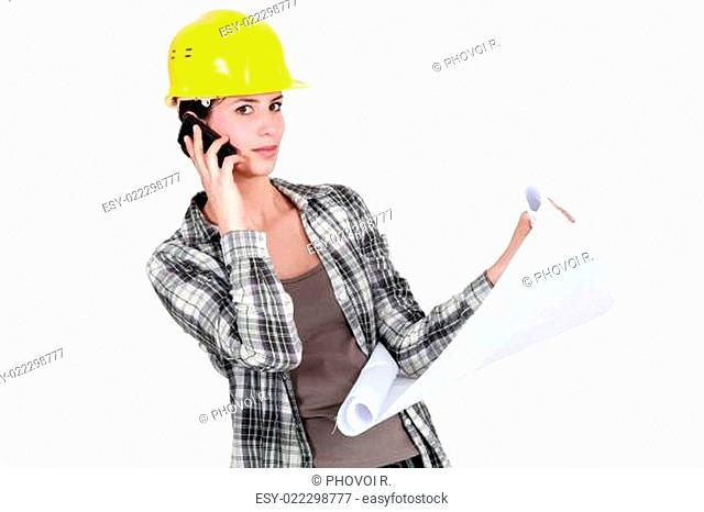 A foreman on the phone going over the plans