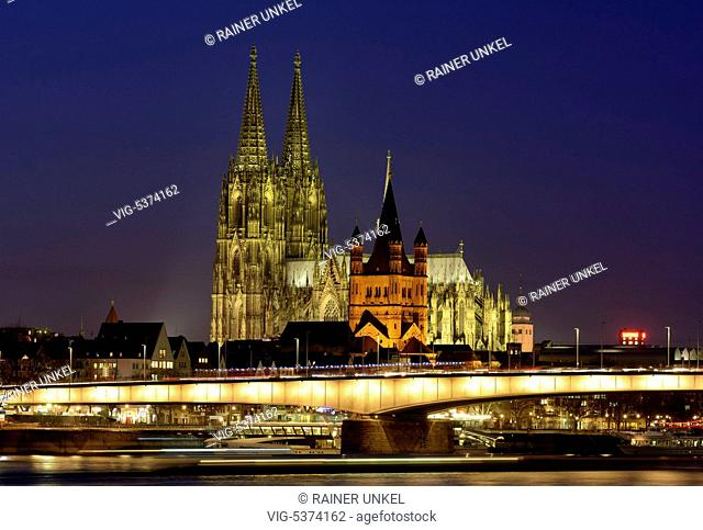 DEU , GERMANY : Cologne Cathedral in Cologne at Rhine river , in front is Great St.Martin church and Deutz Bridge , 09.12