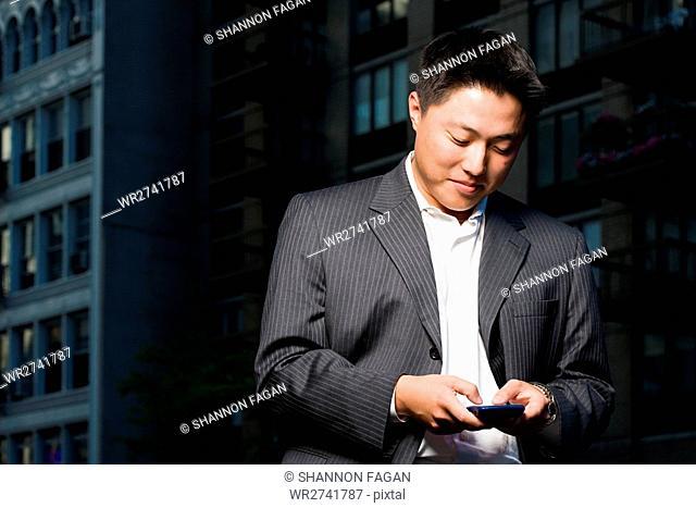 Man using handheld computer