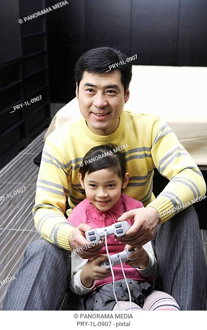Father and duaghter playing video game