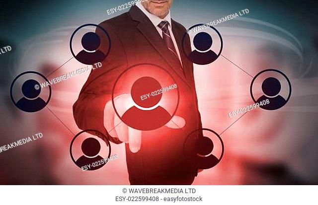 Businessman selecting futuristic interface of social network icons