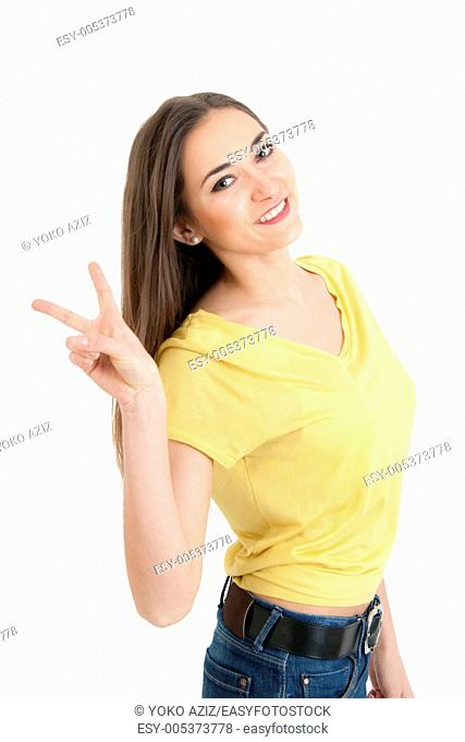 Portrait of young woman with a welcoming smile shows you the peace sign