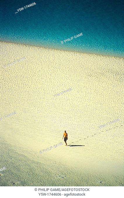 Solitary figure on the beach at Whitsunday Island, Queensland, Australia