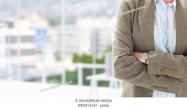 Hands folded with watch on blurred background