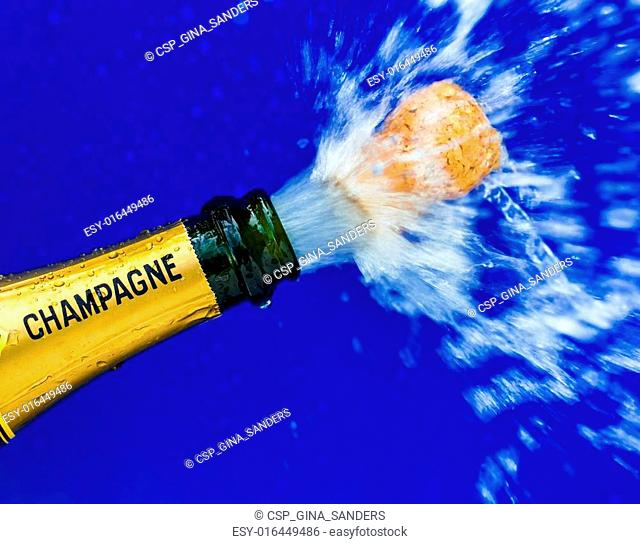 champagne bottle is opened