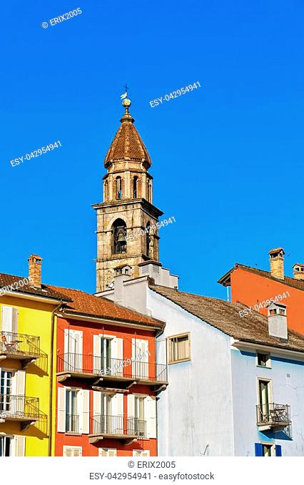 St Peter and Paul church tower and colorful buildings at luxurious resort of Ascona on Lake Maggiore, Ticino canton, Switzerland