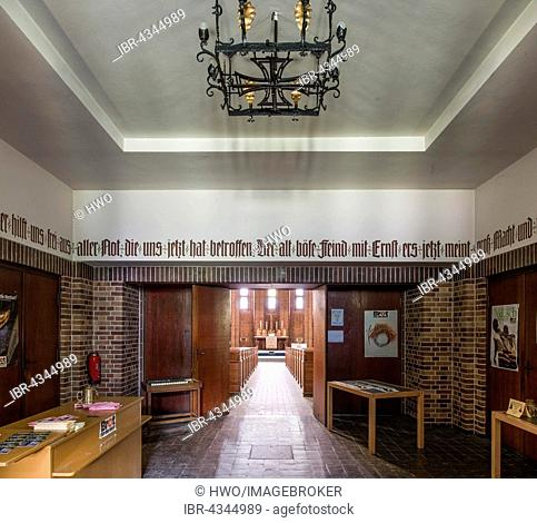 Iron Cross as chandelier, ideological abuse of Luther's hymn A Mighty Fortress.., vestibule with Nazi symbolism, Martin Luther Memorial Church, 1933 to 1935