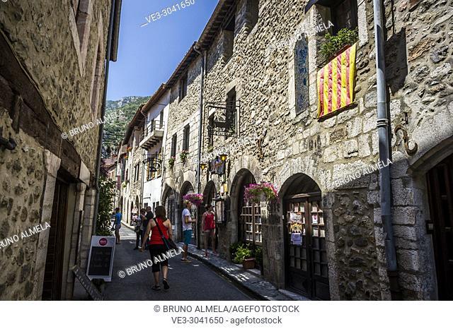Flag of Roussillon in a medieval street, Villefranche-de-Conflent (department of Pyrénées-Orientales, region of Occitanie, France)