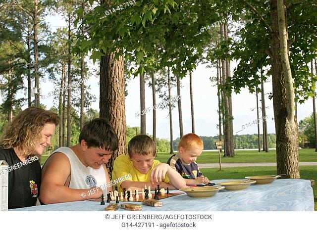 Boys, mother, chess, campground. Chattahoochee River, Lakepoint Resort State Park. Lake Eufaula, Alabama. USA