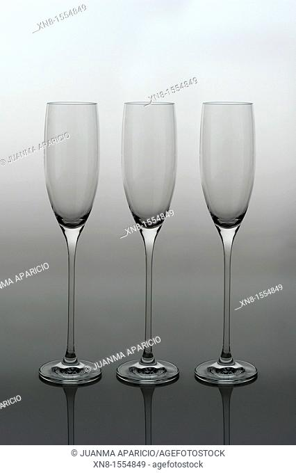 Three crystal Champagne glasses photographed backlit on vertical gradient