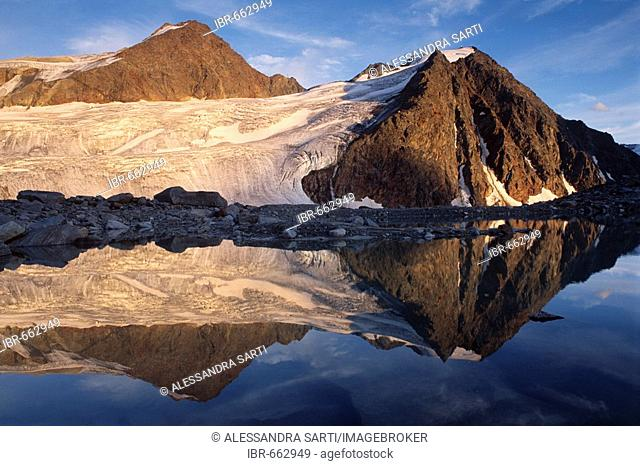 Mt. Schwarze Schneid reflected on the surface of an alpine lake in the Oetztal Alps, North Tirol, Austria, Europe
